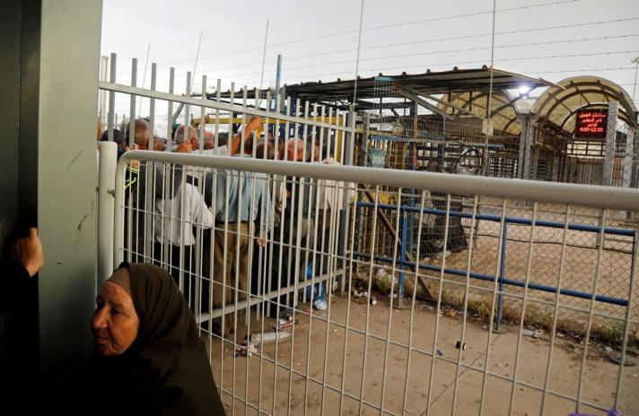 Palestinian workers wait to cross the Israeli-controlled Al-Jalama checkpoint as they head to work in Israel, near Jenin in the West Bank, May 2, 2019. [Credit: Raneen Sawafta / Reuters]