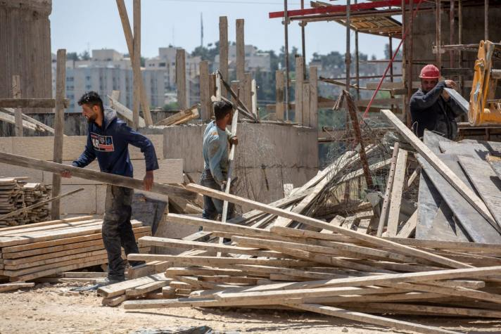 Palestinian workers in Jerusalem, May 2019. Credit: Emil Salman [Haaretz]