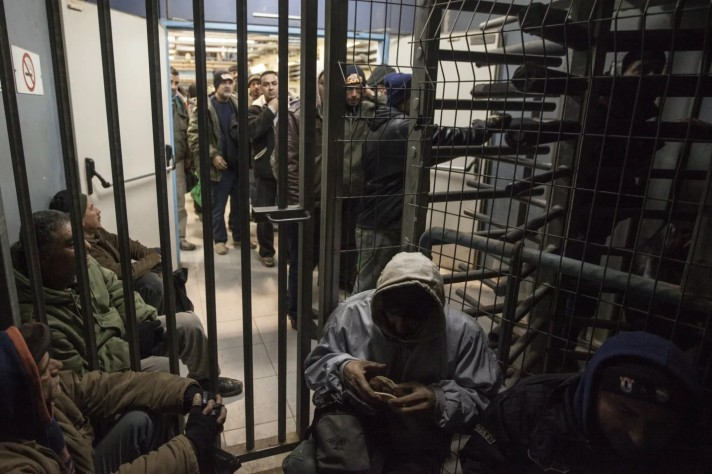 Palestinians crossing the Sha'ar Efraim checkpoint separating Israel and the West Bank.Credit: Tomer Appelbaum [Haaretz]