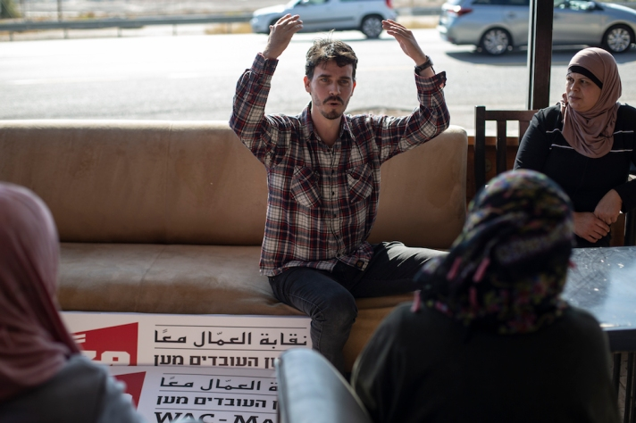 WAC-MAAN representative Yoav Tamir speaks to Palestinian workers on strike during a solidarity meeting in Almog junction, West Bank, December 5, 2019. (Activestills.org)