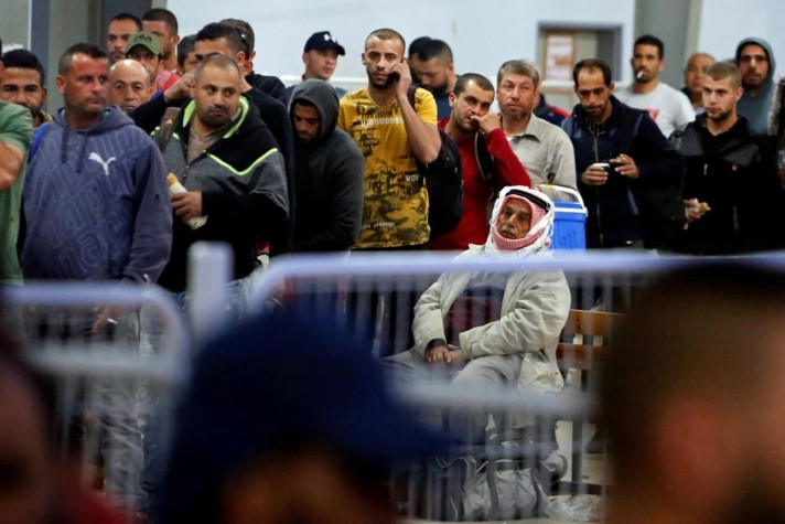 Palestinian workers waiting at a checkpoint near Jenin as they head to work in Israel, May 2, 2019. Credit: Raneen Sawafta / Reuters