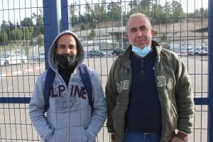 Ahmad Atawneh (r) and Haidar Atawneh (l), Palestinian workers from from the village of Beit Kahel, at the Tarqumiya checkpoint, the West Bank. (Photo: Activestills)