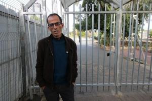 Maher Al-Sheikh, a Palestinian worker from the village of Sanniriya, at the Israeli checkpoint near Qalqilya, the West Bank. (Photo: Activestills)