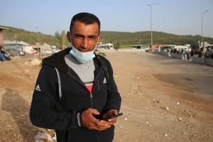 Mahmoud Awad, a Palestinian worker, at the Tarquimya checkpoint near Hebron, the West Bank. (Photo: Activestills)