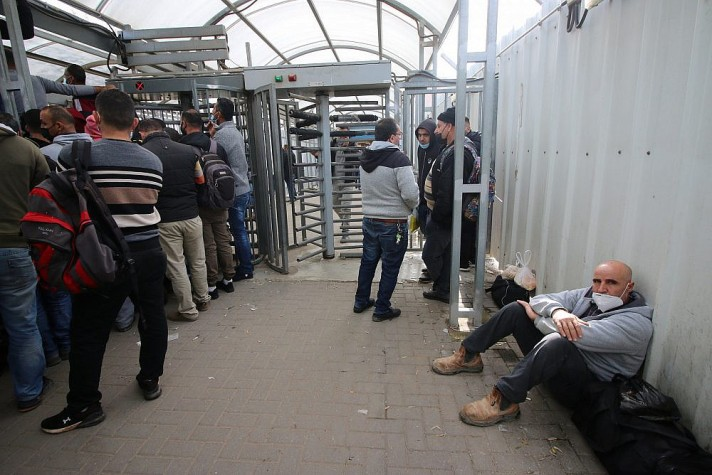 Palestinian workers in line to receive COVID-19 vaccinations at the Qalqilya checkpoint, the West Bank. (Photo: Activestills)